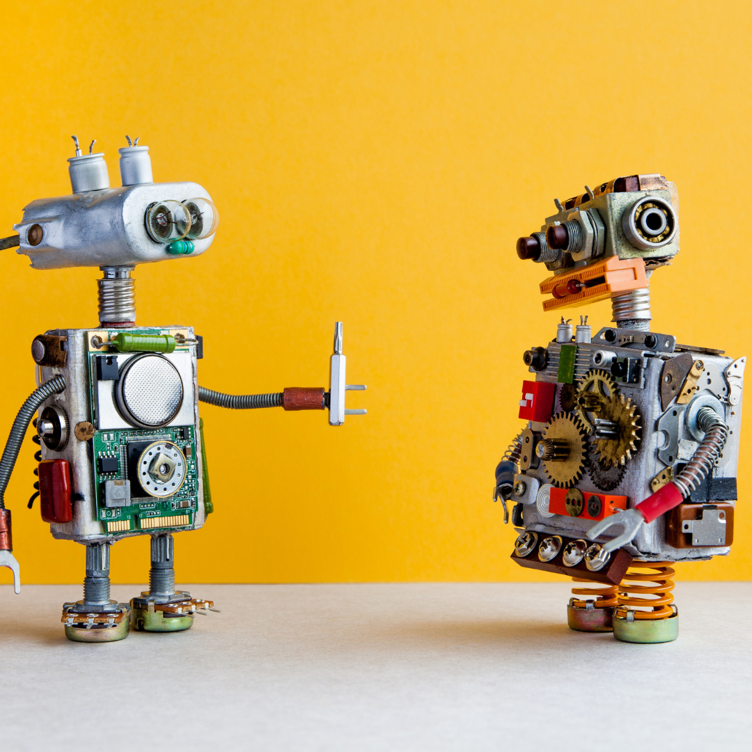 Two robots interacting to represent automation
