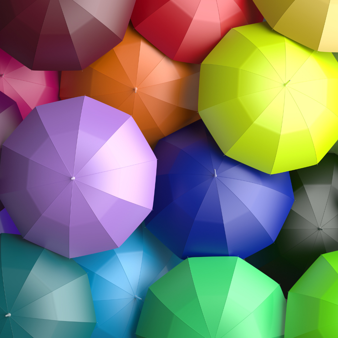 Open umbrellas of different colours to represent diversity