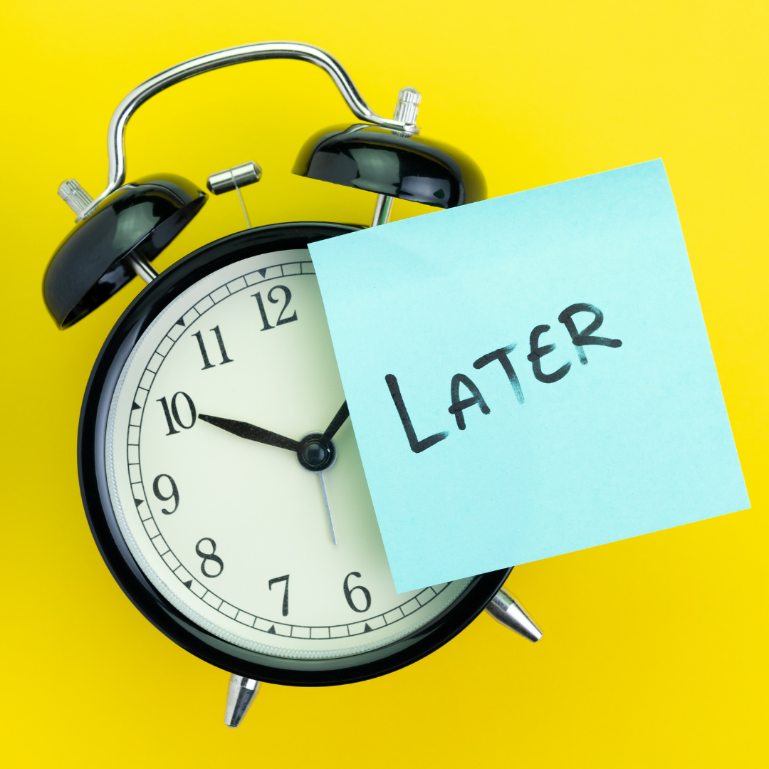A clock with a post-it note that says later on it to represent procrastination